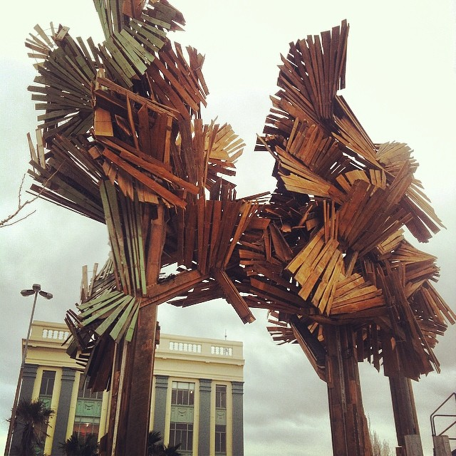 'The Wood From The Trees' art installation by Regan Gentry Cnr Tuam & High Sts. in #Christchurch. The wood has been recovered from an earthquake damaged/destroyed home. #StreetArt