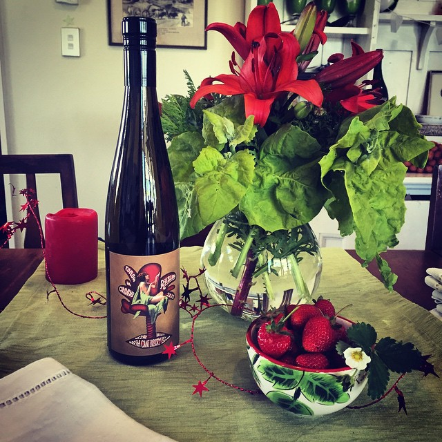 The Tongue in Groove Riesling is looking mighty fine on the #FoodFarm #Christmas party table. The bouquet includes orach - a #NZ perpetual spinach & shungiku, an edible chrysanthemum from the garden, and Narissa's lilies from the @waipara_valley_farmers_market. And #FoodFarm strawberries of course! #NZChristmas