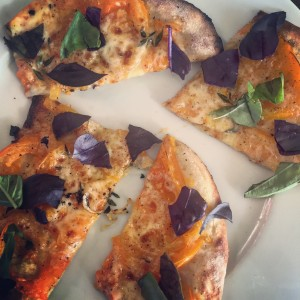 Fresh tomato pizza. Always put the basil on after you've taken it out of the oven!